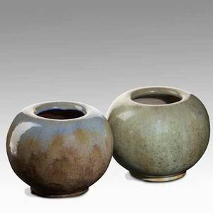Fulper two spherical vases one in leopard skin crystalline glaze the other in blue and frothy elephants breath glaze vertical marks each 5 34 x 6 34