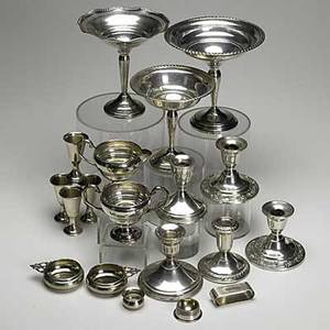 American sterling 20th c sixteen pieces five weighted low candlesticks three weighted footed compotes pair of gorham porringers four cordial cups alvin open salt baldwin and miller napkin ring