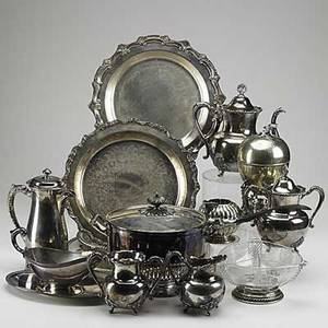 American and european silverplate sixteen pieces includes english egg coddler with falcon finial and gryphon legs woodman  cook four piece tea set etc tallest 9
