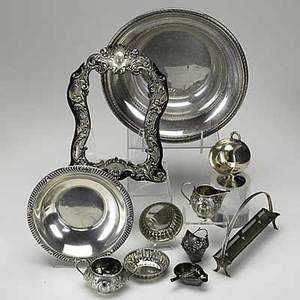Collection of silver holloware and accessories sugar scuttle german 800 silver cream and sugar service gorham sterling mounted picture frame invalid spoon bowl reticulated basket two nut dishes