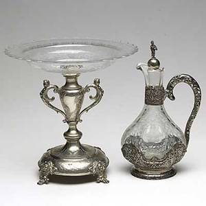 Continental silver mounted crystal ca 1900 two pieces wyler sterling mounted cruet with openwork handle and a young man figural stopper austrian 800 silver compote with wheel cut crystal bowl t