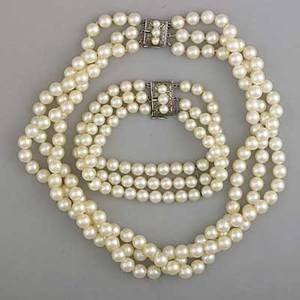 Akoya pearl threestrand necklace and bracelet retailed by asahi shoten tokyo ca 1960 necklace longest strand 16 pearls 7mm bracelet 7 pearls 6mm both with silver clasps unknotted 109