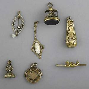 Collection of antique gold jewelry and accessories eight pieces cigar cutter with diamond two pendants with pearls and diamonds pin with cherub two antique hardstone fobs 9 ct london bridge mu