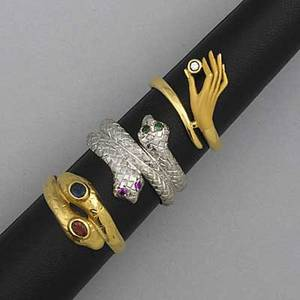 Gold bypassstyle rings three rings snake with emerald and ruby eyes in 14k wg size 7 snake with sapphire and ruby eyes in 14k yg size 9 12 hand holding diamond approx 02 ct in 14k yg size