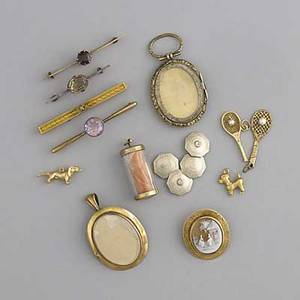 Collection of assorted gold or goldfilled jewelry fourteen pieces four bar pins five charms for charm bracelet cameo pin locket pendant pair cufflinks one pin is silver two charms are not go