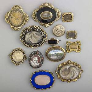 Victorian mourning and souvenir jewelry ca 1940 thirteen gold goldfilled and goldplated brooches one silver pin 146 gs gw largest 2 18
