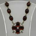 Cherry amber necklace scroll pendant and goldfilled link chain with oval cherry amber cabochons each 14mm x 10mm ca 1900 16