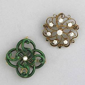 Gold pendantbrooches ca 1900 two brooches green enamel over 14k yg with 3mm pearl center by hedges 1 oec diamonds approx 1 cts tw in 14k rose gold 1 124 gs gw