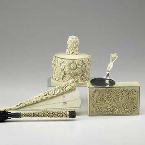 Asian ivory grouping five pieces 19th20th c two lidded boxes umbrella fan and spatula largest 4 12 x 3 12 x 5 34