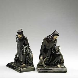 Rookwood pair of production bookends st francis of assisi shape no 6883 20th c stamped and dated 1945 7 12
