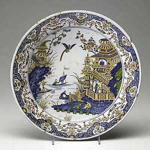 Delft charger with polychrome asian design in reds blues and yellow 18th c signed wl 11 2 x 13 34 dia
