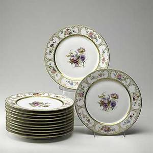 Limoges twelve dinner plates with floral patterns and gilded borders early 20th c marked limoges wg  co france 10 78 dia
