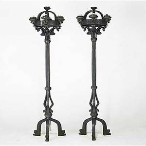 Pair of wrought iron torcheres gargoyle decoration electrified 20th c 93 x 27 dia