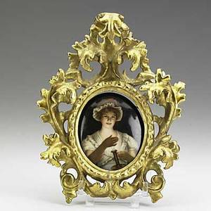 Painting on porcelain depicting a maiden with a chamberstick in elaborate gilt frame 19th c illegibly stamped artist signed wagner 7 12 x 5 34