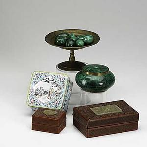 Decorative grouping tiffany studios tazza filled with malachite eggs round malachite covered box chinese enamel box and two cinnabar boxes with jade inserts 19th20th c largest 3 12 x 6 12