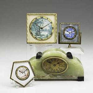 Swiss enamel dresser clocks grouping of three with painted dials 20th c together with a french art deco onyx and marble clock with replaced movement largest 7 12 x 4 x 1 14