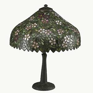 Style of handel table lamp leaded glass shade with floral motif and patinated bronze base late 20th c 22 x 18 dia
