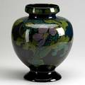 Gouda vase decorated in the style of rozenburg 20th c marked 12 12 x 10