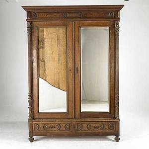 Victorian furniture oak twodoor armoire with later back asfound condition missing shelves hardware together with disassembled oak wardrobe parts with carved panels early 20th c hardware on