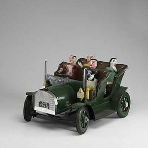 Folk art three pieces molded and sculpted town scene sculpture of an antique car with four passengers and sculpture of a stagecoach all 20th c tallest 18 12