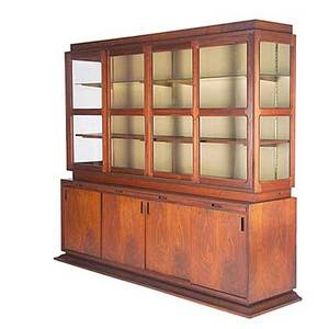 Stanley prowler walnut cabinet with sliding glass doors wood and glass shelves over three concealed shelves and four sliding cabinet doors enclosing storage space unmarked 84 x 96 x 25