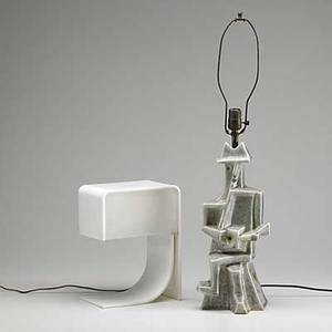 Modern lighting plexiglass table lamp in the style of pierre cardin together with ceramic table lamp with cubist statue of a man playing guitar both unsigned taller 30