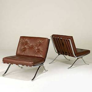 Modern pair of chromed steel and leatherette lounge chairs unmarked 31 x 29 x 32