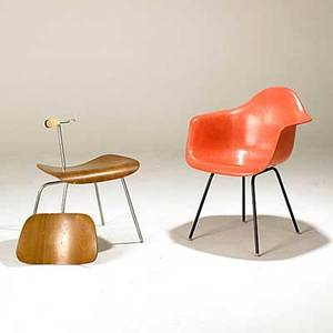 Charles  ray eames herman miller fiberglass armshell chair together with walnut dcm both have labels armshell 31 12 x 25 x 22 12 dcm 26 x 19 12 x 22