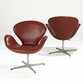 Arne jacobsen fritz hansen pair of leather and matte chromed steel swan chairs foil labels 32 12 x 31 x 27