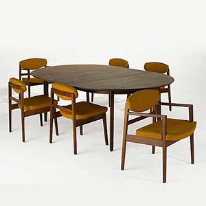 Edward wormley dunbar george nelson herman miller walnut dining table together with six walnut dining chairs two with arms table has rectangular brass dunbar tag chairs have a foil herman mille