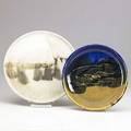 Toshiko takaezu two glazed porcelain platters provenance acquired directly from the artist shallow bowl incised tt platter has accumulation of glaze on back hiding probable signature 9 12 and