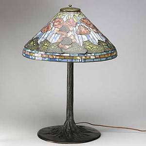 Tiffany style contemporary table lamp with leaded poppy shade and trunkshaped bronze 4light base 28 12 x 20 34 dia
