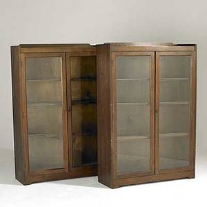 Style of stickley bros pair of twodoor bookcases each with three adjustable shelves and gallery top 51 12 x 35 x 12