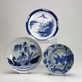 Japanese porcelain three pieces in blue and white 19th20th c bowl with man playing flute riding oxen charger depicting mt fuji bowl with light green overglaze and wise men dancing gold repai