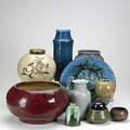 Art pottery grouping eight pieces 20th c nils kohler tall blue glazed vase octagonal stoneware vase clown charger etc tallest 12 34