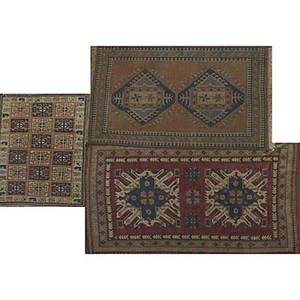 Three oriental area rugs two turkish and one caucasian design 20th c largest 58 x 96