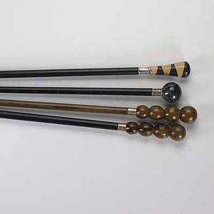 Flann lippincott four silver mounted walking sticks italy ca 2000 cannonball turned black marble turned inlaid birch and walnut two cannonball turned rosewood one with ebonized stick and horn t