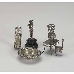 European silver six items mostly of german 800silver miniature chairs and table tea strainer figural baby rattle scent flask silvered bronze cherub on plinth 10 x 8 x 3