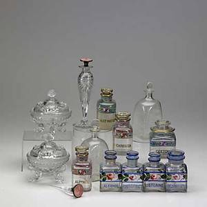 Art glass grouping twelve pieces 19th20th c silver mounted cut glass perfume two etched dresser bottles seven handpainted medicine jars and two covered candy dishes talles 8 14