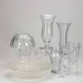 Decorative glass twentyfour pieces include two dorothy thorpe etched vases cut and pressed glass and champagne flutes tallest 11