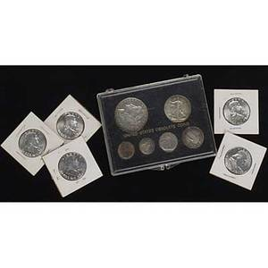 American coins and currency twenty au 50 1963 franklin halves united states obsolete coins sixcoin set 1964 proof set approx 900 wheat pennies three silver bicentennial coin sets two silver