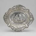 European silver centerbowl pierced and deeply chased classical scene of a man making advances toward a young lady reclined with another lady holding sheep cherub and garland border hanau germany