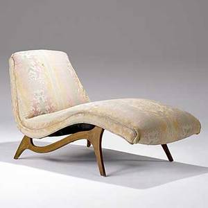 Style of vladimir kagan fabricupholstered chaise lounge on sculpted walnut base 32 x 32 x 47