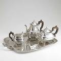 Gion portuguese 916silver coffee service porto 19381984 three halfreeded cushionshaped vessels on ball and paw feet shaped rosewood handles 8 34 coffee pot 7 tea pot 5 cream pitcher 202