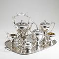 Dominick  haff silver tea and coffee service ca 1930 six pieces and a similar shreve  co covered sugar bowl on associated silverplated copper tray everted pear shapes on ring foot kettle on sta