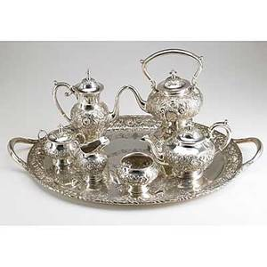 S kirk  son silver repousse coffee service six pieces and oval tray in the baltimore rose pattern 19321961 10 coffee pot 6 14 teapot 4 12 cream pitcher and covered sugar bowl 3 waste b