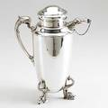 Udall  ballou silver cocktail pitcher new york ca 1921 georgian style on three dolphin feet dolphin handle and spout with chained cap 412 ot 11 12