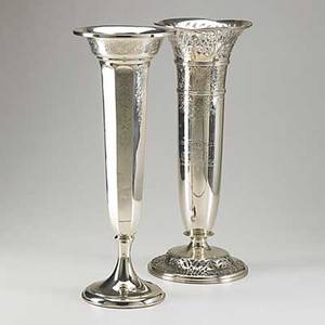 Two tall american silver vases ornate example pierced and chased inscribed and dated 1915 paneled trumpet form with foliate engraving inscription presented to nathan king foreman of the may 1915
