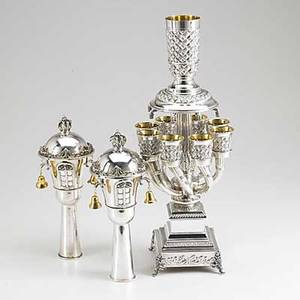 20th c silver judaica kiddush cup tree with eight basketweave cups and a master cup on curved branches marked hadad 925 18 18 pair of silver rimonim with gilt bells crown finials and applied wi