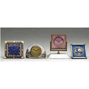 Four ornamental bronze desk clocks 19001940 swiss scenic enamel demi lune art deco egyptian revival enamel swiss scenic and blue guilloche enamel swiss pink guilloche on white onyx base eight da